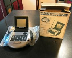 WORLD WIDE TRAVEL ALARM CLOCK WITH CALCULATOR AND FM SCANNER